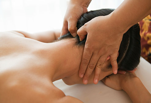 Man lying on table getting a neck massage